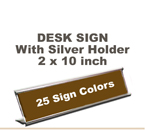 Shown here is a 2X10 Engraved Sign including a Silver slide in Desk holder.