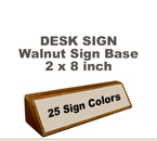 Shown here is a 2X8 Engraved Sign including a hand rubbed Walnut Desk holder.
